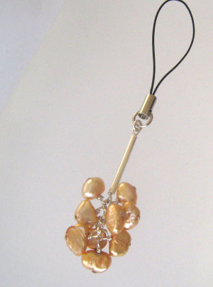 Golden pearl charm