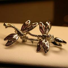 Exquisite solid silver enamelled brooch.