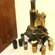 Swift brass/black mono microscope