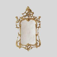 Elegant Rococo looking glass with scrolling frame.