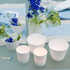Set of 4 white porcelain tea lights