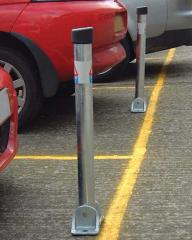 Hinged lockable parking post