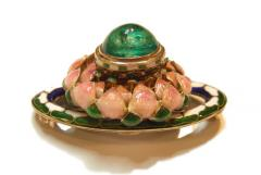 A gold, emerald and enamel brooch by Henry Wilson