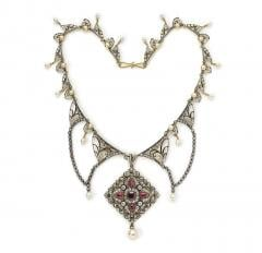 A jewelled and enamelled gold necklace by Carlo