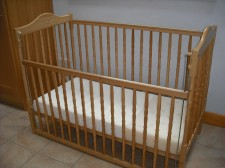 The wooden dropside cot