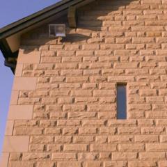 Doddington pink pitched faced sandstone walling